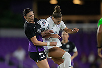 ORLANDO, FL - SEPTEMBER 11: Taylor Kornieck #22 of the Orlando Pride and Jorian Baucom #33 of Racing Louisville FC battle for the ball during a game between Racing Louisville FC and Orlando Pride at Exploria Stadium on September 11, 2021 in Orlando, Florida.