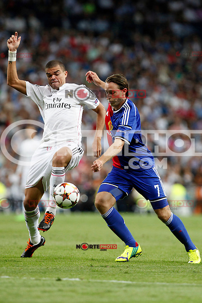 Pepe of Real Madrid and Luca Zuffi of FC Basel 1893 during the Champions League group B soccer match between Real Madrid and FC Basel 1893 at Santiago Bernabeu Stadium in Madrid, Spain. September 16, 2014. (ALTERPHOTOS/Caro Marin) /NortePhoto.com