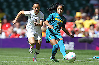 MAURINE of Brazil and Hayley MOORWOOD of New Zealand - New Zealand Women vs Brazil Women - Womens Olympic Football Tournament London 2012 Group E at the Millenium Stadium, Cardiff, Wales - 28/07/12 - MANDATORY CREDIT: Gavin Ellis/SHEKICKS/TGSPHOTO - Self billing applies where appropriate - 0845 094 6026 - contact@tgsphoto.co.uk - NO UNPAID USE.