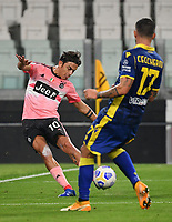 Calcio, Serie A: Juventus - Hellas Verona, Turin, Allianz Stadium, October 25, 2020.<br /> Juventus' captain Paulo Dybala (l) in action with Hellas Verona's Federico Ceccherini (r) during the Italian Serie A football match between Juventus and Hellas Verona at the Allianz stadium in Turin, October 25,,2020.<br /> UPDATE IMAGES PRESS/Isabella Bonotto