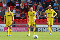 The Fleetwood Town players show their dejection after going 2-1 behind<br /> <br /> Photographer David Shipman/CameraSport<br /> <br /> The EFL Sky Bet League One - Doncaster Rovers v Fleetwood Town - Saturday 17th August 2019  - Keepmoat Stadium - Doncaster<br /> <br /> World Copyright © 2019 CameraSport. All rights reserved. 43 Linden Ave. Countesthorpe. Leicester. England. LE8 5PG - Tel: +44 (0) 116 277 4147 - admin@camerasport.com - www.camerasport.com