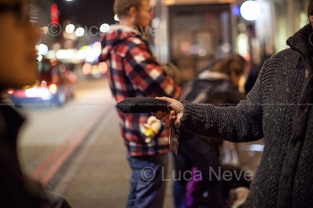 "London, 16/12/2015. This evening, members of the public lead by ""Street Kitchens"" - a non-profit organisation that provides information and help for homeless people - met outside Camden Town Station for ""distributing and collecting essential items to those who may need them on our streets"". Around 8:30PM, a small group of people moved towards King's Cross and Euston stations trying to help homeless people outside two of the major London's train stations. Wool hats, gloves, jumpers, trousers, shoes, tooth paste and brushes, coats, and then cups of tea and hot soups, sandwiches, water, bowls of rise, biscuits and a lot of company and smiles were donated this evening to the homeless people who are facing the London's cold winter. <br />