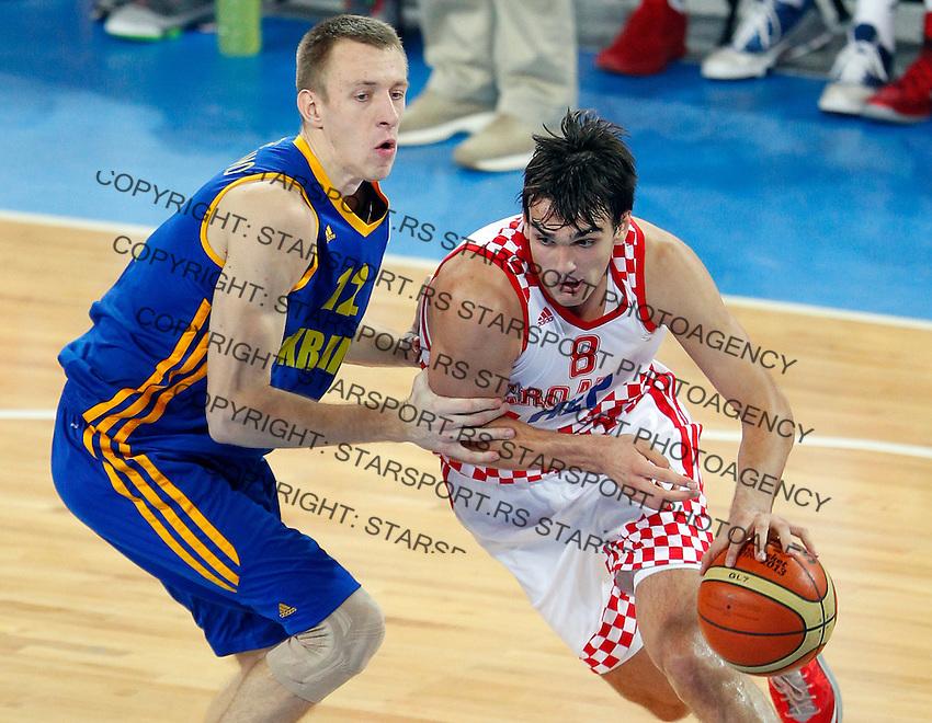 "Dario Saric of Croatia (R) in action during European basketball championship ""Eurobasket 2013"" quarter-final basketball game between Croatia and Ukraine in Stozice Arena in Ljubljana, Slovenia, on September 19. 2013. (credit: Pedja Milosavljevic  / thepedja@gmail.com / +381641260959)"