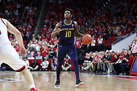 RALEIGH, NC - JANUARY 9: T.J. Gibbs #10 of the University of Notre Dame dribbles the ball during a game between Notre Dame and NC State at PNC Arena on January 9, 2020 in Raleigh, North Carolina.