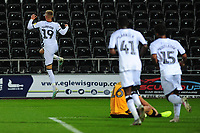 Sam Surridge of Swansea City celebrates scoring his side's fifth goal during the Carabao Cup Second Round match between Swansea City and Cambridge United at the Liberty Stadium in Swansea, Wales, UK. Wednesday 28, August 2019.