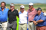Miguel Angel Jiminez of Spain poses for a photo with caddies and fellow Spanish golfers Santiago Luna and Miguel Angel Martin on the 13th tee ahead of The Senior Open Golf Tournament at The Royal Porthcawl Golf Club in South Wales, which begins tomorrow.