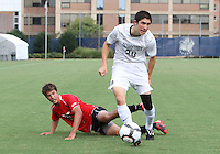 Andy Riemer #20 of Georgetown University avaids a tackle from Ryan Burnham #9 of Northeastern University during an NCAA match at North Kehoe Field, Georgetown University on September 3 2010 in Washington D.C. Georgetown won 2-1 AET.