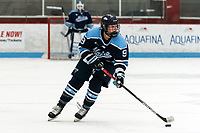 BOSTON, MA - JANUARY 04: Ali Beltz #9 of University of Maine brings the puck forward during a game between University of Maine and Boston University at Walter Brown Arena on January 04, 2020 in Boston, Massachusetts.