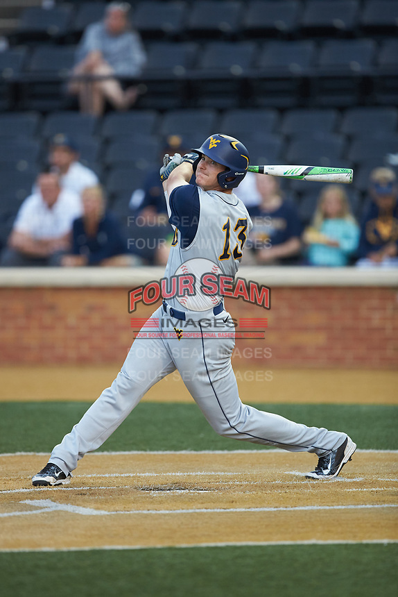 Jackson Cramer (13) of the West Virginia Mountaineers follows through on his swing against the Wake Forest Demon Deacons in Game Six of the Winston-Salem Regional in the 2017 College World Series at David F. Couch Ballpark on June 4, 2017 in Winston-Salem, North Carolina. The Demon Deacons defeated the Mountaineers 12-8. (Brian Westerholt/Four Seam Images)