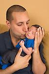 Father kissing newborn baby boy
