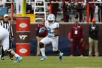 BLACKSBURG, VA - OCTOBER 19: Michael Carter #8 of the University of North Carolina runs the ball during a game between North Carolina and Virginia Tech at Lane Stadium on October 19, 2019 in Blacksburg, Virginia.