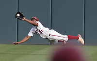 Arkansas outfielder Christian Franklin (25) forces an out, Monday, June 7, 2021 in the NCAA Fayetteville Regional at Baum-Walker Stadium in Fayetteville. Check out nwaonline.com/210608Daily/ for today's photo gallery. <br /> (NWA Democrat-Gazette/Charlie Kaijo)