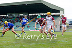 Kevin Hannafin, St. Brendans, in action against Muiris Delaney and John Mike Dooley, Causeway, during the County Senior hurling Semi-Final between St. Brendans and Causeway at Austin Stack park on Sunday.