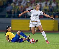 Carli Lloyd, Cristiane. The USWNT defeated Brazil, 1-0, to win the gold medal during the 2008 Beijing Olympics at Workers' Stadium in Beijing, China.
