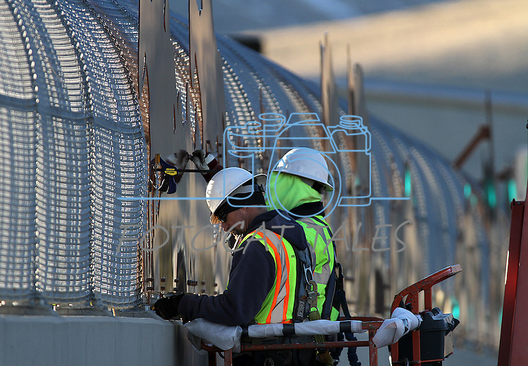 """Crews install """"cattle drive image panels"""" on the Fairview overpass above the Highway 395 bypass on Monday afternoon in Carson City. The work is part of the Carson City Freeway Landscape Project that includes landscape, art and history along the freeway corridor..Photo by Cathleen Allison"""