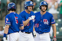 Round Rock Express outfielder Jared Hoying (30) is greeted by teammates Jason Donald (5) and Brad Snyder (25) after hitting a first inning home run during the Pacific Coast League baseball game against the Omaha Storm Chasers on June 1, 2014 at the Dell Diamond in Round Rock, Texas. The Express defeated the Storm Chasers 11-4. (Andrew Woolley/Four Seam Images)