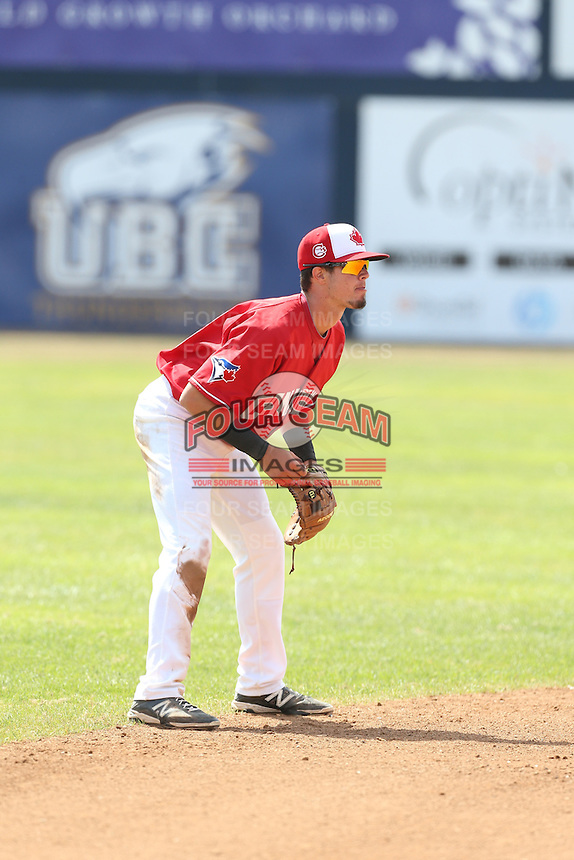J.C. Cardenas (18) of the Vancouver Canadians in the field at shortstop during a game against the Eugene Emeralds at Nat Bailey Stadium on July 22, 2015 in Vancouver, British Columbia. Vancouver defeated Eugene, 4-2. (Larry Goren/Four Seam Images)