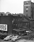 Pittsburgh PA:  View of Friendly Inn on Forbes Avenue from Magee Street in the uptown section of Pittsburgh near Duquesne University.  The assignment was for a developer trying to get some of the buildings condemned so he could get them at a good price for future development.
