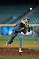 Baylor Bears relief pitcher Luke Boyd (41) delivers a pitch to the plate against the Arkansas Razorbacks in game nine of the 2020 Shriners Hospitals for Children College Classic at Minute Maid Park on March 1, 2020 in Houston, Texas. The Bears defeated the Razorbacks 3-2. (Brian Westerholt/Four Seam Images)