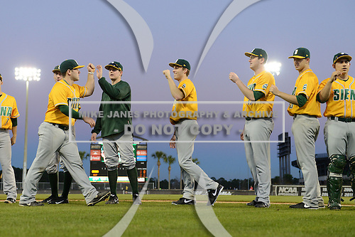 Siena Saints introductions before the season opening game against the Central Florida Knights at Jay Bergman Field on February 14, 2014 in Orlando, Florida.  UCF defeated Siena 8-1.  (Copyright Mike Janes Photography)