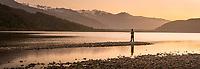 Fishing on pristine Lake Mapourika under Southern Alps at sunset, Westland Tai Poutini National Park, West Coast, UNESCO World Heritage, South Island, New Zealand, NZ