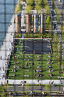 NEW YORK, NY - MAY 15: View of groups of people making use of the circles they held in Domino Park for people to use social distance from the Williamsburg Bridge on May 15, 2020 in Brooklyn, NY. COVID-19 has spread to most countries in the world, claiming more than 303,000 infected lives for more than 4.5 million people, although in some cities the pandemic has controlled deaths and infections continue. Mayor Bill de Blasio says the city, along with New York police, will launch a pilot program in public parks this weekend to monitor crowds (Photo by Pablo Monsalve / VIEWpress via Getty Images)