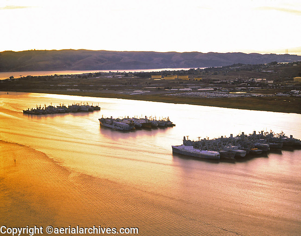 aerial photograph of the mothball fleet, Suisun Bay,  Solano County, California at sunset, 1999