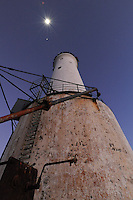 Great Basses Reef Lighthouse of SW Sri Lanka towers with its double galleries towards the moon.