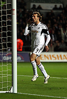 Pictured: Michu of Swansea (L) celebrating his equaliser, making the score 2-2. Monday 16 September 2013<br /> Re: Barclay's Premier League, Swansea City FC v Liverpool at the Liberty Stadium, south Wales.