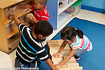 Education Preschool first days of school boys and girl working together on block construction