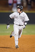 Ben Breazeale (9) of the Wake Forest Demon Deacons hustles towards third base against the Davidson Wildcats at Wilson Field on March 19, 2014 in Davidson, North Carolina.  The Wildcats defeated the Demon Deacons 7-6.  (Brian Westerholt/Four Seam Images)