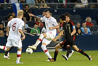 Marcus Haber (10) Canada holds off Mexico defenders... Mexico defeated Canada 3-1 in Olympic Qualifying semi final at LIVESTRONG Sporting Park, Kansas City, Kansas.