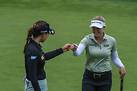 16th July 2021, Midland, MI, USA;  In Gee Chun (KOR) congratulates Brooke M. Henderson (CAN) after sinking their birdie putt on 14 during the Dow Great Lakes Bay Invitational Rd3 at Midland Country Club on July 16, 2021 in Midland, Michigan.