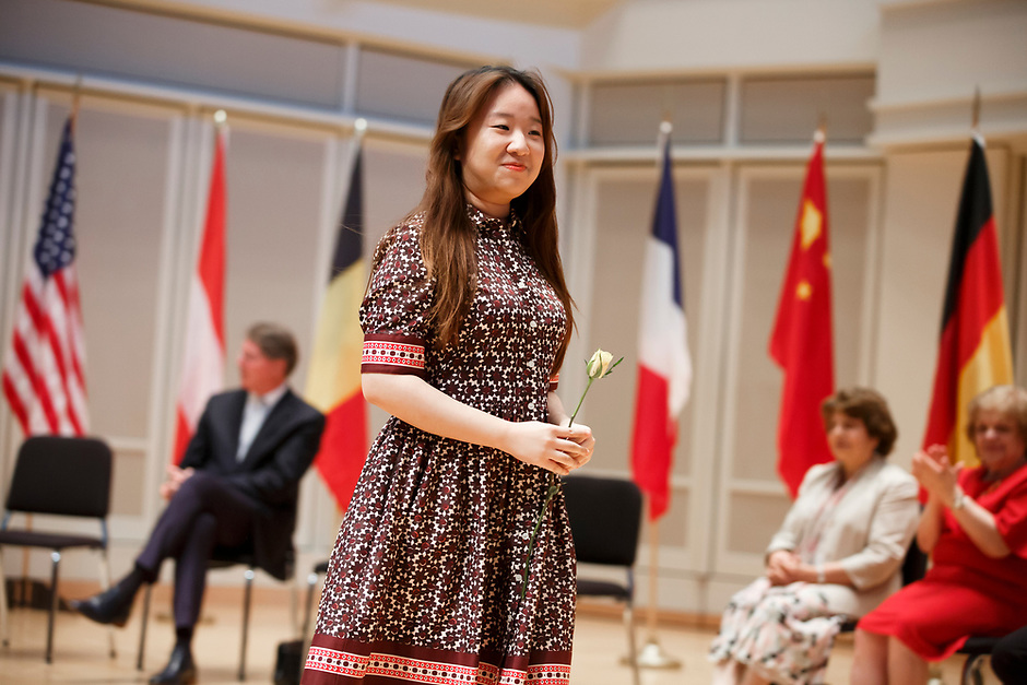 A contestant receives a rose during the opening ceremony of the 11th USA International Harp Competition at Indiana University in Bloomington, Indiana on Wednesday, July 3, 2019. (Photo by James Brosher)