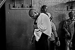 Mike Tyson takes a break while at Gleason's Gym to train young local boxers. Tyson agreed to 100 hours of community service, training young boxers, as part of a plea deal agreement  to avoid assault charges. Brooklyn , New York  March 11, 2004. Photo by Thierry Gourjon-Bieltvedt