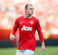Wayne Rooney (10) of Manchester United looks for the ball during the friendly at FedEX Field in Landover, MD.  Manchester United defeated FC Barcelona, 2-1.