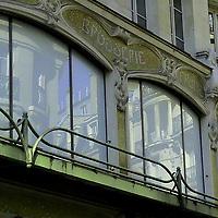 Elegant characteristic Parisian buildings that are reflected on the windows of an antique magazine, under its sign (Paris, 2007).<br /> <br /> Eleganti edifici tipicamente Parigini, riflessi nelle finestre di un antico magazzino, sotto la sua insegna (Parigi, 2007).