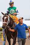 March 28, 2015: Jockey John Velazquez being lead into the winners circle after winning the G1 Florida Derby on Materiality. Scenes from Florida Derby Day. Gulfstream Park, Hallandale Beach (FL). Arron Haggart/ESW/CSM