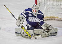 13 February 2015: University of New Hampshire Wildcat Goaltender Vilma Vaattovaara, a Junior from Veikkola, Finland, makes a first period save against the University of Vermont Catamounts at Gutterson Fieldhouse in Burlington, Vermont. The Lady Wildcats defeated Vermont 4-2 in the first game of their weekend Hockey East series. Mandatory Credit: Ed Wolfstein Photo *** RAW (NEF) Image File Available ***