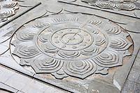 Nanjing, Jiangsu, China.  Niushou Mountain Buddhist Ashram Lotus Decoration on Floor.