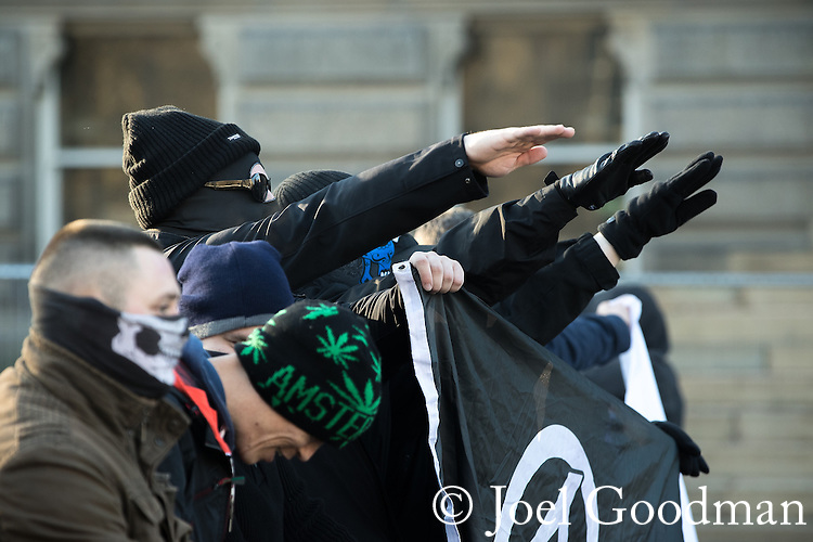 """© Joel Goodman - 07973 332324 . FILE PICTURE DATED 26/11/2016 of National Action supporters performing a Nazi salute at an anti mosque demonstration in Bolton , UK , as today, 12th December 2016 , the British Government have laid out an order in Parliament to use anti terrorism legislation to ban the Neo-Nazi group """" National Action """" . Approximately 100 people attend a demonstration against the construction of mosques in Bolton , under the banner """" No More Mosques """" , organised by a coalition of far-right organisations . Photo credit : Joel Goodman"""