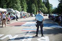 gendarmes rule the climb<br /> <br /> 2014 Tour de France<br /> stage 13: Saint-Etiènne - Chamrousse (197km)