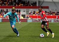 22nd May 2021; Brentford Community Stadium, London, England; English Football League Championship Football, Playoff, Brentford FC versus Bournemouth; Tariqe Fosu of Brentford being marked by Jack Stacey of Bournemouth