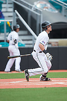 Zach Remillard (7) of the Coastal Carolina Chanticleers follows through on his swing against the Bryant Bulldogs at Springs Brooks Stadium on March 13, 2015 in Charlotte, North Carolina.  The Chanticleers defeated the Bulldogs 7-2.  (Brian Westerholt/Four Seam Images)