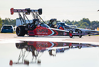 Jul 12, 2020; Clermont, Indiana, USA; The dragsters of NHRA top fuel driver Steve Torrence (near) and Antron Brown reflect in a puddle during the E3 Spark Plugs Nationals at Lucas Oil Raceway. This is the first race back for NHRA since the start of the COVID-19 global pandemic. Mandatory Credit: Mark J. Rebilas-USA TODAY Sports