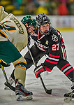 17 December 2013:  Northeastern University Huskies Forward Dalen Hedges, a Freshman from Ottawa, Ontario, takes a face-off against the University of Vermont Catamounts at Gutterson Fieldhouse in Burlington, Vermont. The Huskies shut out the Catamounts 3-0 to end UVM's 5 game winning streak. Mandatory Credit: Ed Wolfstein Photo *** RAW (NEF) Image File Available ***