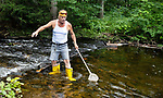 WOLCOTT, CT. - 21 July 2021-072121SV01-Mark Kalinowski of Wolcott checks the Mad River for invasive gold fish he believes were dumped into the river in Wolcott Wednesday. The DEEP were on scene earlier in the day and removed some of the fish.<br /> Steven Valenti Republican-American