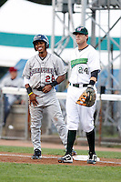 Mahoning Valley Scrappers shortstop Francisco Lindor #28, the Indians first round draft choice, smiles at pitcher Jose Fernandez - a fellow first round draft pick and Florida prep star - after a pick off attempt as first baseman Brian McConkey #24 looks on during the first inning of a game against the Jamestown Jammers at Russell E. Diethrick Jr Park on September 2, 2011 in Jamestown, New York.  Mahoning Valley defeated Jamestown 8-4.  (Mike Janes/Four Seam Images)