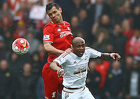Dejan Lovren of Liverpool and Andre Ayew of Swansea City in action during the Barclays Premier League match between Swansea City and Liverpool played at the Liberty Stadium, Swansea on 1st May 2016