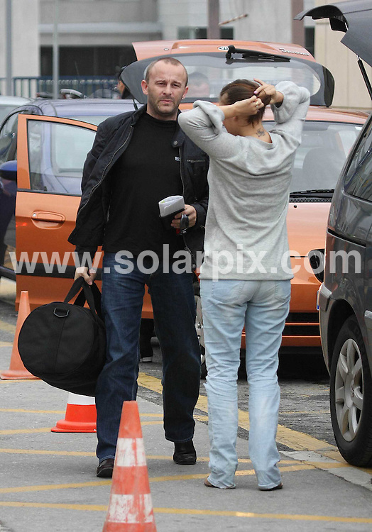 **ALL ROUND EXCLUSIVE PICTURES FROM SOLARPIX.COM**.**WORLDWIDE SYNDICATION RIGHTS**.Kerry Katona said goodbye to husband Mark Croft as he left Spain at Malaga airport this morning and returned to her hotel alone. The couple were away to shoot a GMTV program in the sun, but unfortunately the heavens opened as Mark disappeared to the check in. Kerry, who is the face of Iceland adverts, is hoping to show off her new figure after having ops to reduce the size of her bust and also her stomach. .JOB REF:  7565    AB1        DATE:  10.10.08.**MUST CREDIT SOLARPIX.COM OR DOUBLE FEE WILL BE CHARGED* *UNDER NO CIRCUMSTANCES IS THIS IMAGE TO BE REPRODUCED FOR ANY ONLINE EDITION WITHOUT PRIOR PERMISSION*